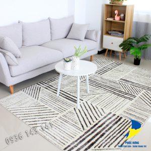 Thảm lót sàn nhà đẹp với bộ sofa văng